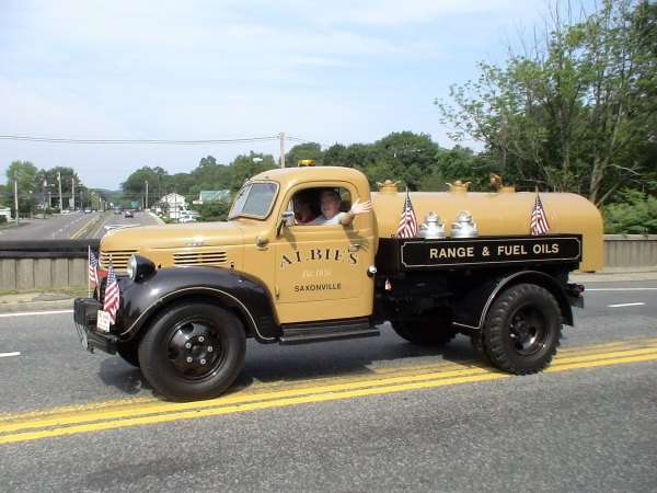 Charlie Rousseau driving a vintage Albie's Oil truck in 2011 Natick 4th of July Parade