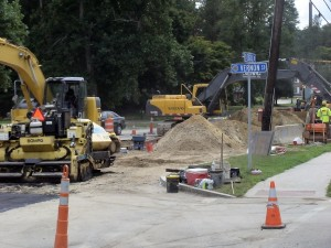 Construction workers install sewer mains near Framingham Centre Common, (August 2011)