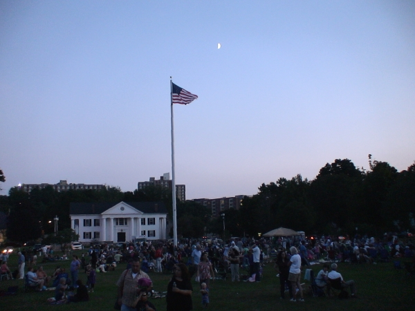 The crowd is slow to leave as dusk settles over the Village Green and OFF THE HOOK finishes up its last set.