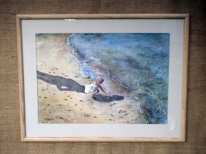 Watercolor by Deborah Bottomley of young girl playing in the surf in the shadow of a watchful parent.