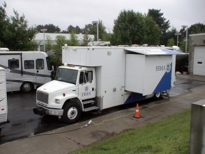 Photo - FEMA and Dept. of Homeland Security mobile command centers meet at the MEMA bunker in Framingham to coordinate emergency efforts for Hurricane Irene (Aug. 2011)