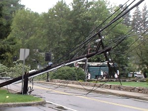 Photo - Close up of one of the phone poles on Salem End Road in Framingham, (near Temple Street), which were taken down by a tree blow over by Hurricane Irene, (August 28, 2011)