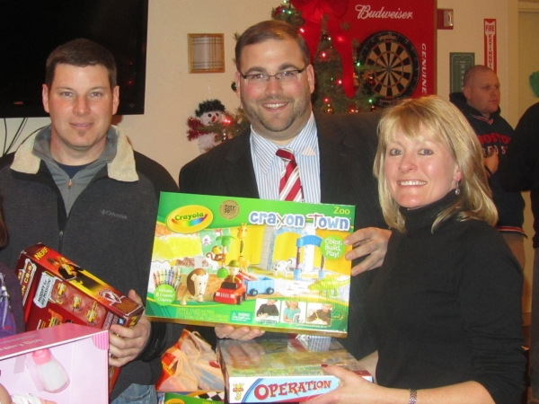 (L-R), Little League President Joe Kaufman, Framingham Selectman Jason Smith and Janet Leombruno at the Framingham Annual Toys for Tots holiday party, (2010).