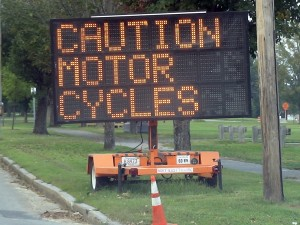Motor cycle caution sign near road construction in Framingham, MA