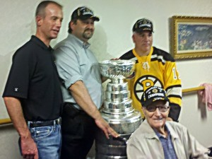 Charlie Jacobs takes time for photo with Bruce Caissie's boss, Bruce, and Uncle Max.