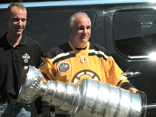 (PHOTO) Charlie Jacobs hands the Stanley Cup to Bruce Caissie, Framingham, MA (September 2, 2011)
