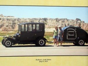 Ribby, his wife, the 1915 Center-Door Model-T and teardrop trailer in the South Dakota Badlands on 2008.