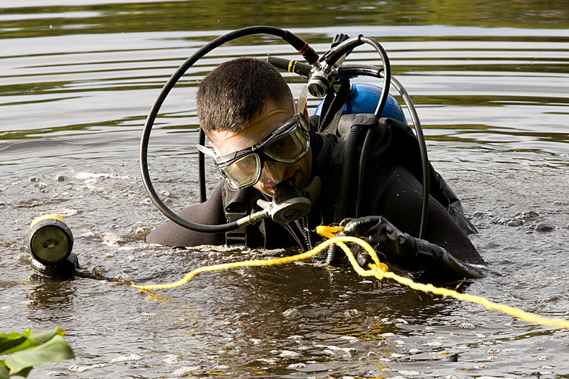 Framingham Police Officers Chris Langmeyer dives in the Sudbury River Saturday, September 24, 2011 during a missing person search.