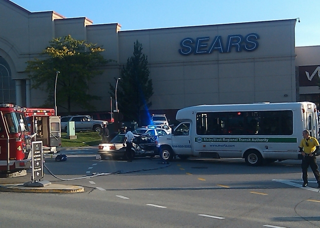 MWTRA bus dwarfs the size of the compact car it collided with behind the Natick Sears store.