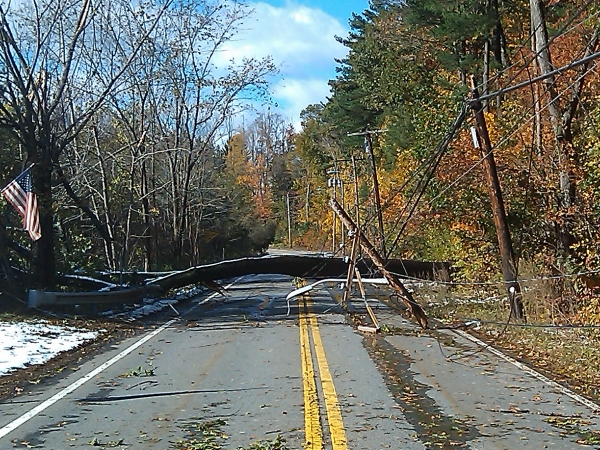 [photo] downed tree and utility pole from Oct. 29, 2011 snow storm close road.
