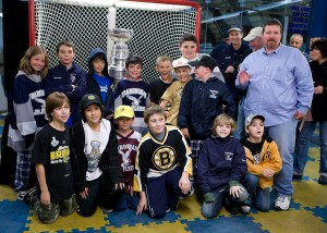 Coach Scott Penrod and his FYHP Squirt ''C2'' Team pose with the Stanley Cup at Loring Arena in Framingham, October 15, 2011.