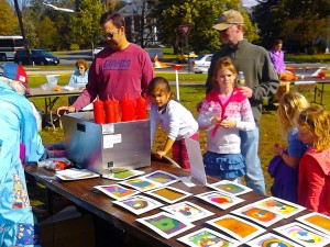 Kids create spin-art at the ''Pies On The Common'' fair at Framingham Centre Common, October 15, 2011.