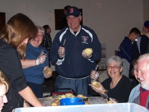 People from all walks of life, roll up their sleeve and help peel potatoes, cut carrots and get the massive amount of food read for the Thanksgiving dinner.