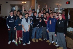 The FHS Flyers Hockey team -- equipped with vegetable peelers, ready to lend a hand to prepare Thanksgiving dinners, (2010 photo).