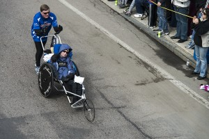 Dick & Rick Hoyt as they pass through Downtown Framingham during the 2013 Boston Marathon.