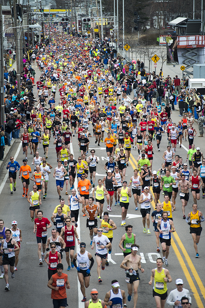 Aerial photo of runners passing through Downtown Framingham in the 2013 Boston Marathon, (photo by Wayne Dion)