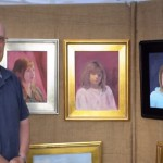 Charles Holt, Framingham, MA Artist Guild Vice President, with some of his portrait work