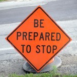 Signs near road construction work advise drivers to Be Prepared To Stop in Framingham, MA.